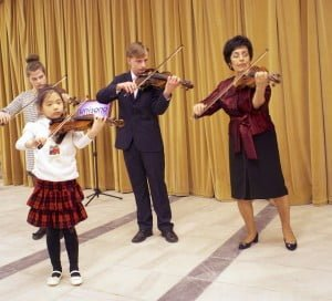 music school in warsaw - teacher and students